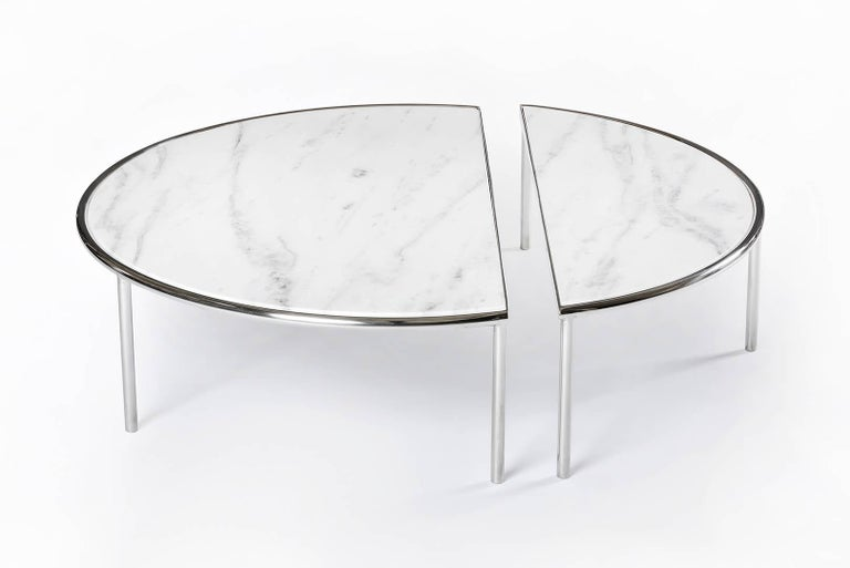Split tables are the result of a subtle intervention in simple geometric forms. A circle and a square are cut, creating tables composed of two independent parts that visually maintains its unity.  The gesture attributes possibilities of