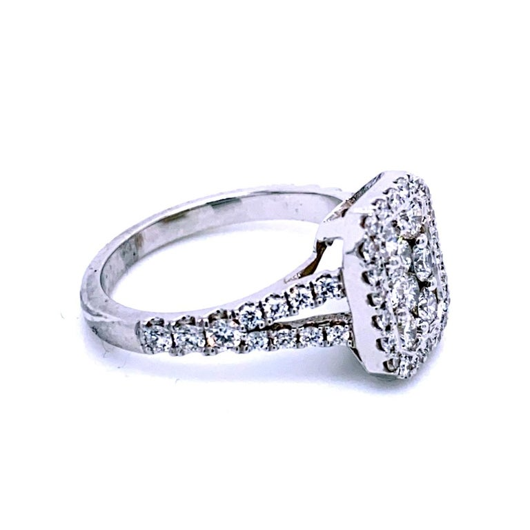 This beautiful Split Shank Diamond Engagement Ring with Halo has a rectangular center wet with a cluster of round diamonds (Size 6.5x8.0 mm Equivalent to a 2 Ct Radiant). Total diamond weight of 1.07 Ct.  Center dimensions 6.5 mm x 8.0 mm  Total