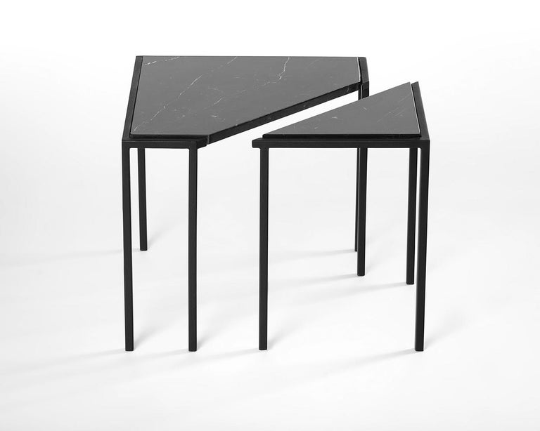 Split tables are the result of a subtle intervention in simple geometric forms. A circle and a square are cut, creating tables composed of two independent parts that visually maintains its unity.