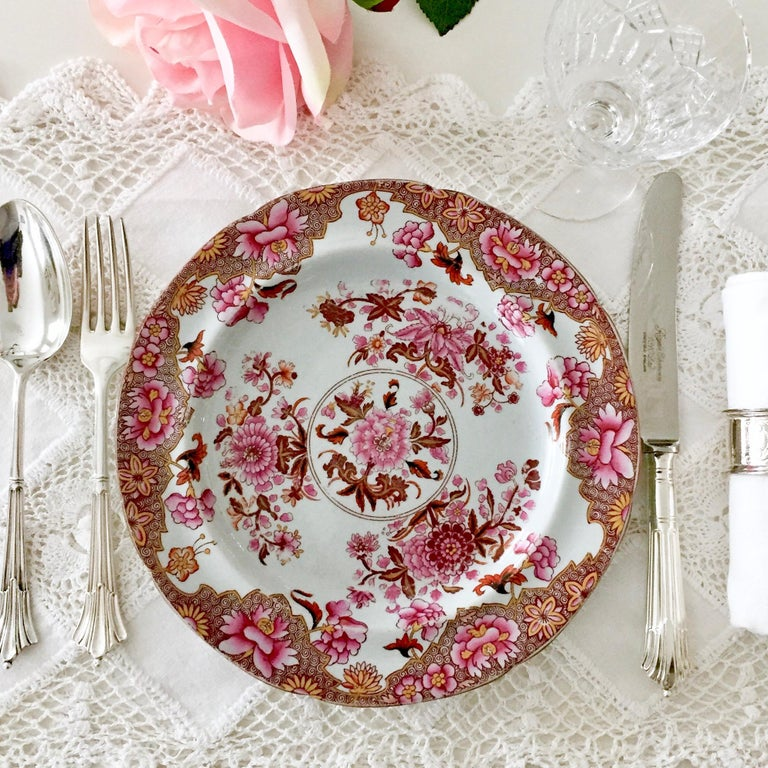 This is a beautiful Spode plate made between 1812 and 1833. The plate is made of stone china and is decorated with a beautiful pink