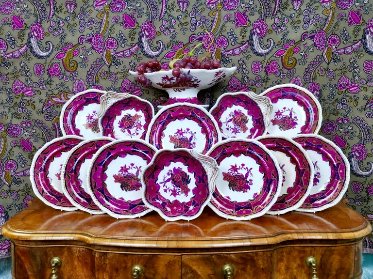 This is a very striking part dessert service made by Spode in about 1828, which is the Regency era. It is made of Spode's Imperial China and has the Frog pattern in mauve/purple. It consists of a high footed comport, three one-handled serving dishes