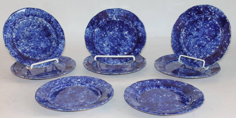 This amazing set of eight matching luncheon plates are in fine condition. They have a amazing glaze and coloration.