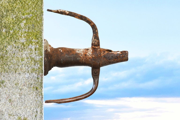 A very rare spout with a wonderful patina. Original and authentic antique solid iron spout. Excellent quality. Rare and unique. Decorative accent. Available right now.