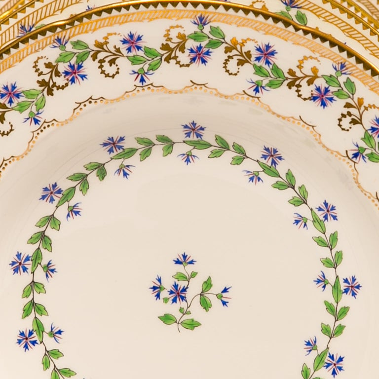 We are pleased to offer this lovely set of eight dishes decorated in the
