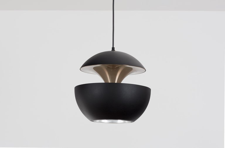 The French architect Bertrand Balas designed the Springfontein (also known as Fountain or Fontaine Jaillissante) for RAAK in the early 1970s.   RAAK manufactured two sizes: one has a diameter of 18 cm and the other 35 cm. This pendant is the