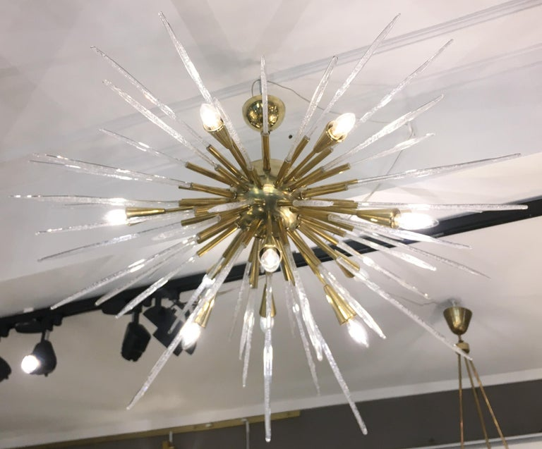 Sputnik chandelier/ceiling light, consisting of a polished brass structure supporting bubble glass