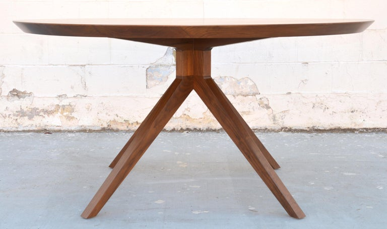 Custom dining table in solid walnut. Shown here in in a 60