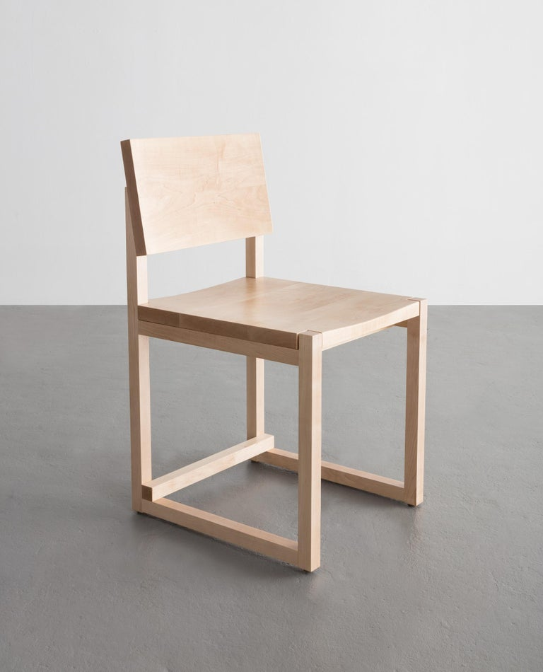 The SQ dining chair believes abstraction becomes principle when adhering to straight lines and rectangular forms.   Shown in maple and also available in ash, white oak, or walnut.