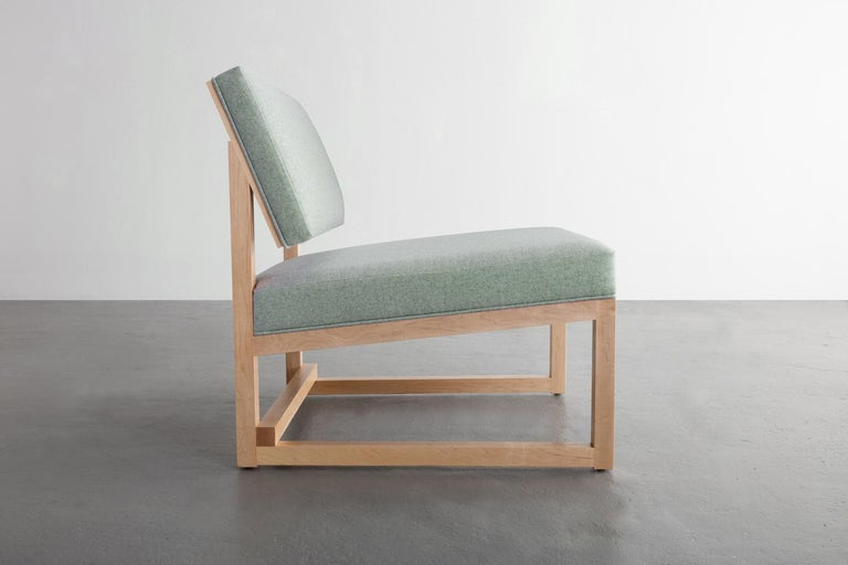 The SQ lounge chair believes that upholding abstraction becomes principle when adhering to straight lines and rectangular forms.   Shown in maple and Maharam Divina wool upholstery.