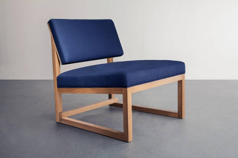 Shown in white oak, maple and walnut. Also available in ash or cherry.  Upholstery shown in Maharam Divina MD by Kvadrat. Also available in COM and COL.