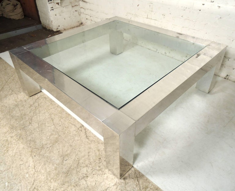Large square chrome frame coffee table with glass. Great for a large living room or office area.