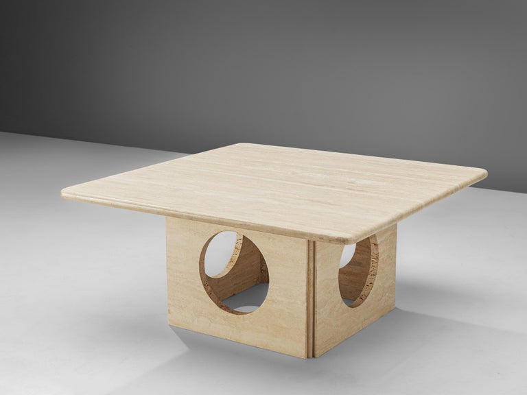 Coffee table, travertine, Italy, 1970s.  This interesting coffee table features a thick squared travertine tabletop with a square base that has four round shaped holes, creating a beautiful play with geometrical lines. These aesthetics are