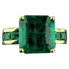 Square Cut 6.70 Carat Emerald Ring in 14 Karat Yellow Gold