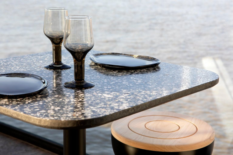 'I' is a collection of tables: coffee / side tables, dining tables, bar tables.  The base and the structures are in steel, and the table top is in terrazzo. by Bentu design   Many models available:  Square dining table - Terrazzo black /