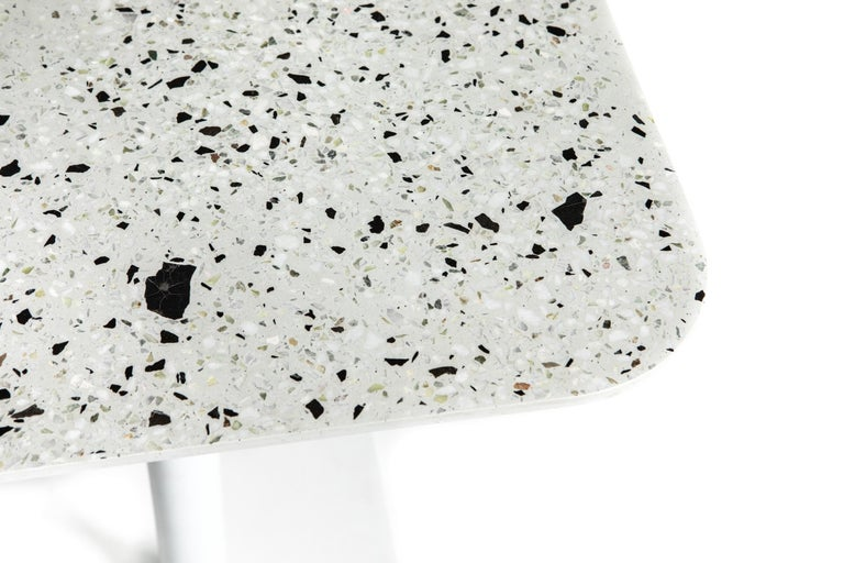 'I' is a collection of tables: coffee / side tables, dining tables, bar tables.  The base and the structures are in steel, and the tabletop is in terrazzo. by Bentu design   Many models available:  Square dining table - Terrazzo black / white