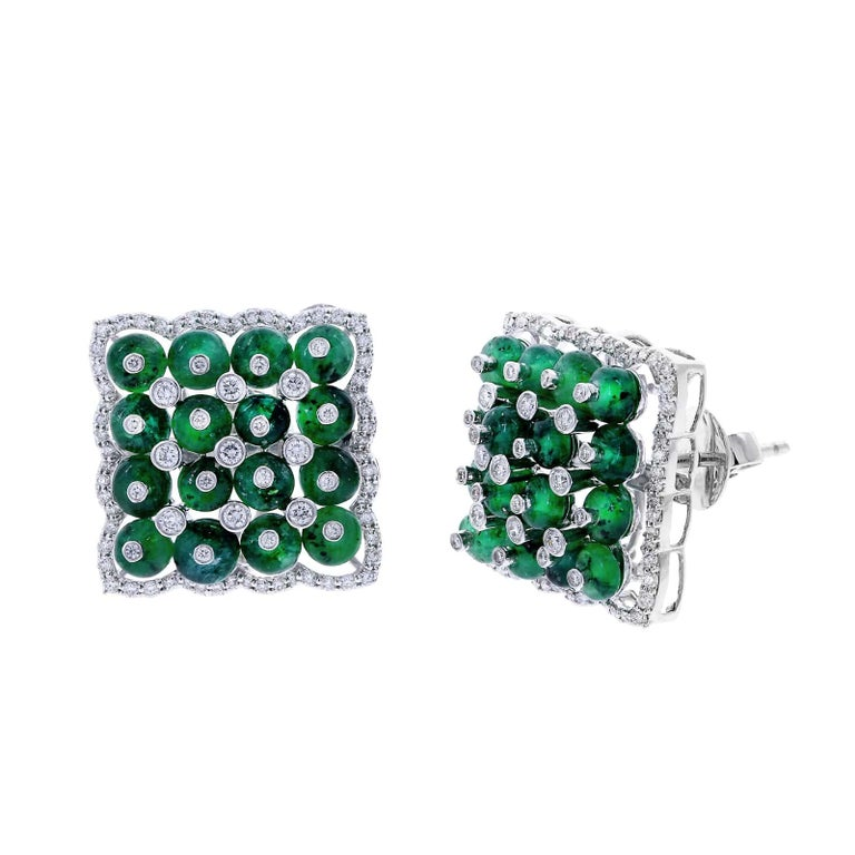 A stunning pair of square earrings with Emerald Beads and Diamonds, falling on the ear in a diamond shape. Total Weight: Diamonds (1.96 cts) and Emeralds (17.37 cts.). 18K White Gold.
