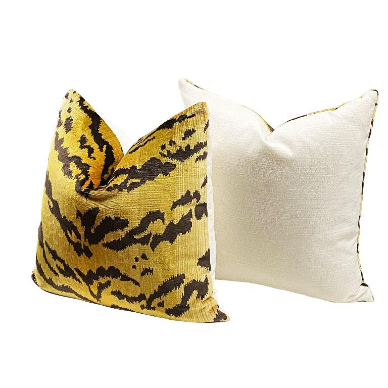 Square shape animal motif tiger print pillow. The front features gorgeous thick velvet animal print. Back features a crisp cream. Down-filled. Knife edge with zipper. Fabric is a designer fabric and originates in Belgium.  Dimensions: 19