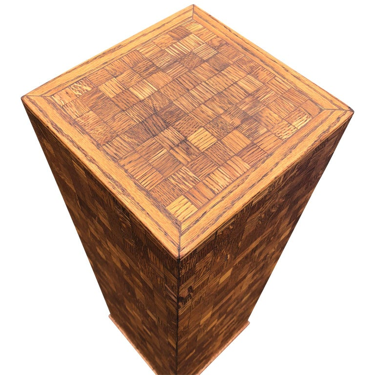 Square Mid-Century Modern wooden pedestal with mosaic wooden tile design.