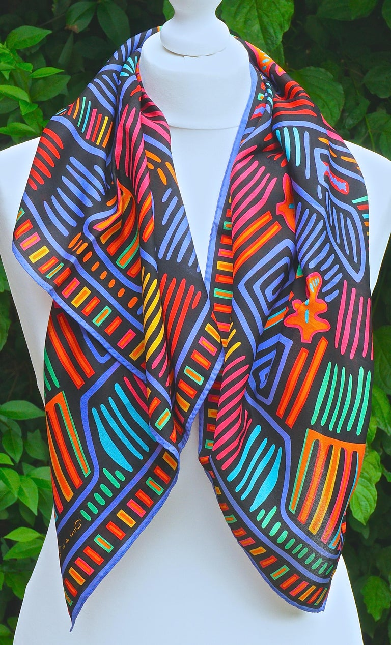 Square Oscar de la Renta for Accessory Street pure silk scarf featuring a lovely multi coloured abstract print on a black background. Measuring approximately 78.74cm / 31 inches square. The scarf is in very good condition, made in Japan.  This