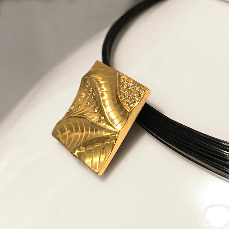 The aptly named Square Pendant (19.5 x 19.5mm) is a beautiful example of what Keiko Mita is trying to accomplish with her Sand Dune Collection . Made from 18k Yellow Gold and 0.21ct Diamonds, the undulating peaks and valleys show the terrain just