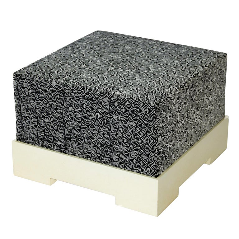 The square pouf is a stunning example of comfort and design combined to produce a contemporary style accessory that is both stylish and functional. With a base in wood that has been covered in matte natural parchment, the pouf is padded and