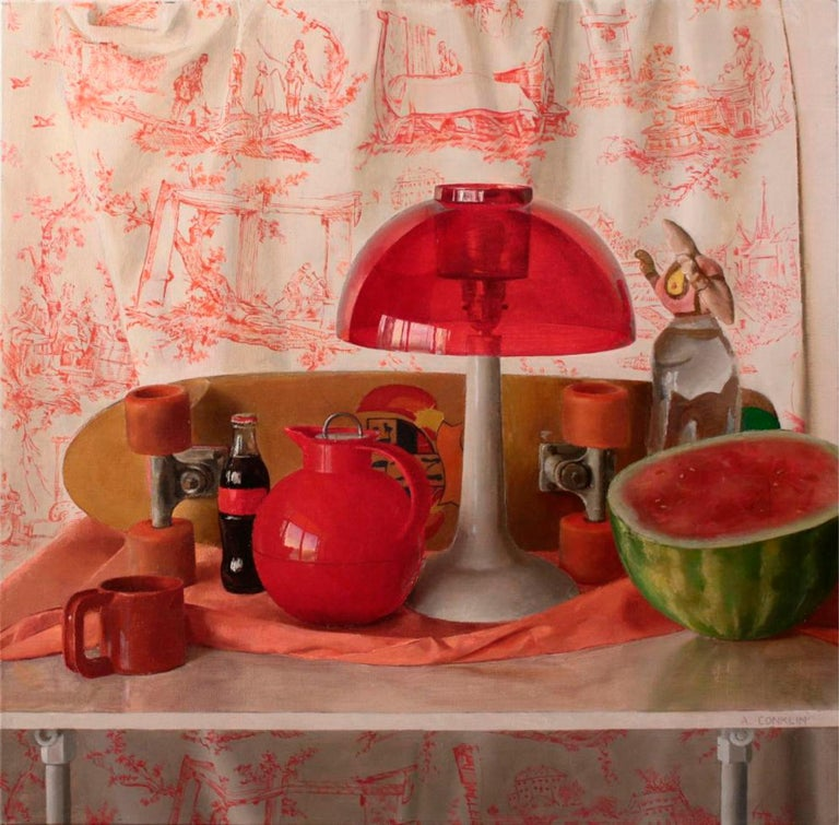 This still life painting on canvas captures a variety of red objects. Among the objects depicted are: skateboard, lamp, coffee cup, midcentury lamp, watermelon, glass coca cola bottle, and doll fragment on top of a bottled water, and a printed