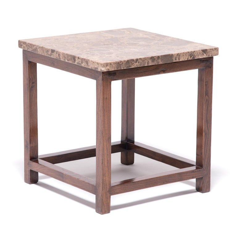 This deceptively simple feng deng (square stool) is a masterpiece of the harmonious design celebrated in traditional Chinese furniture. Clear in construction and pure in materials, the stool is a great example of corner-leg furniture, a box-like