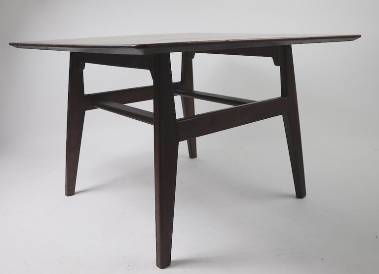 Square table designed by Jens Risom for Jens Risom Design Inc. This example shows cosmetic wear to the finish, as shown. No structural damage, chips, cracks etc.