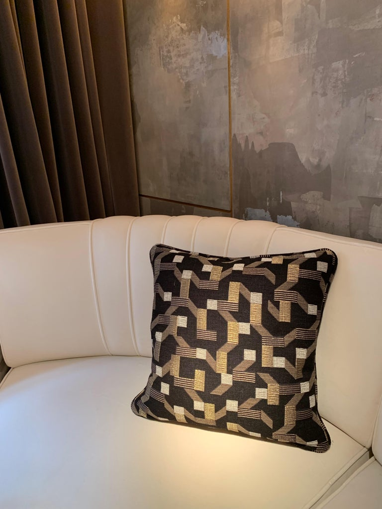 A simple square throw pillow covered in Dedar Pachisi fabric.  The recognisable geometric prints and the expressiveness of 1950 style abstract art is recreated on this wool and cotton upholstery fabric. Playful and labyrinthine, the design is the
