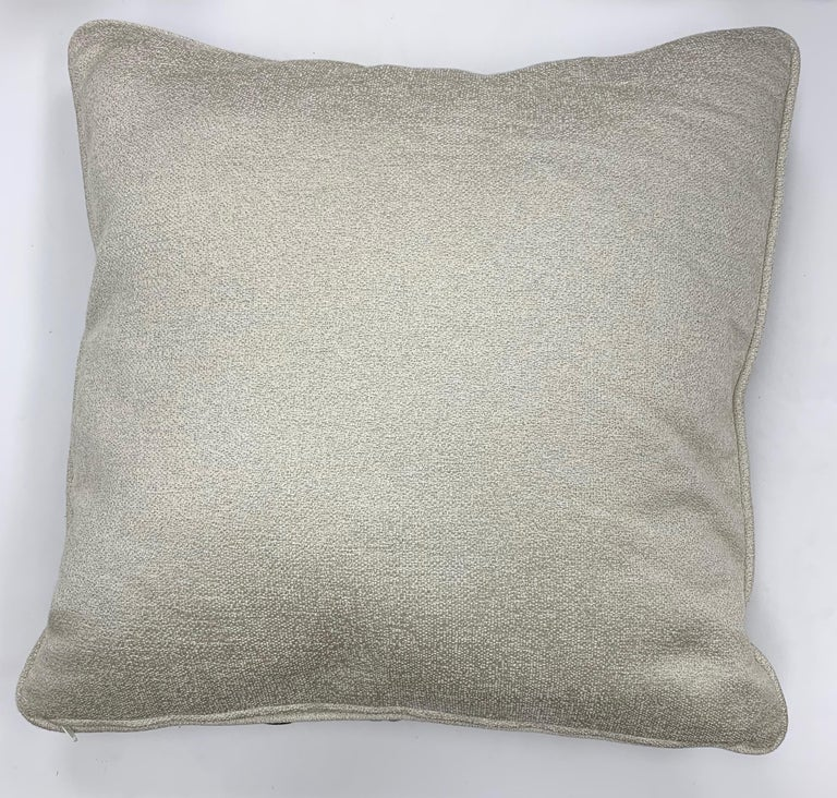 A simple square throw pillow covered in Dedar Reversi and Artemis fabrics.  Reversi - The design is inspired by a classical tartan, revisited in an haute couture key thanks to the use of luminous multicolored yarns. The jacquard technique creates