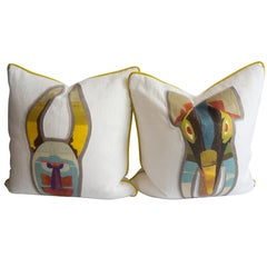 Square Throw Pillows with Animal Mask Appliques