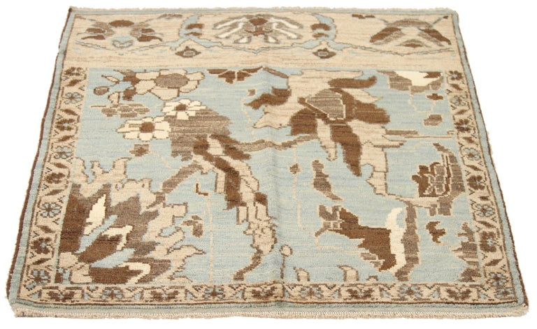New handmade Turkish area rug from high-quality sheep's wool and colored with eco-friendly vegetable dyes that are proven safe for humans and pets alike. It's a modern design using Sultanabad weaving showcasing a regal ivory field with gray and