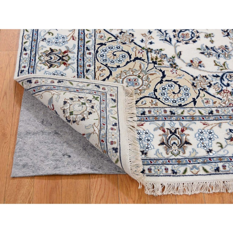 This is a truly genuine one-of-a-kind square wool and silk 250 KPSI ivory Nain hand knotted Oriental rug. It has been knotted for months and months in the centuries-old Persian weaving craftsmanship techniques by expert artisans. Measures: