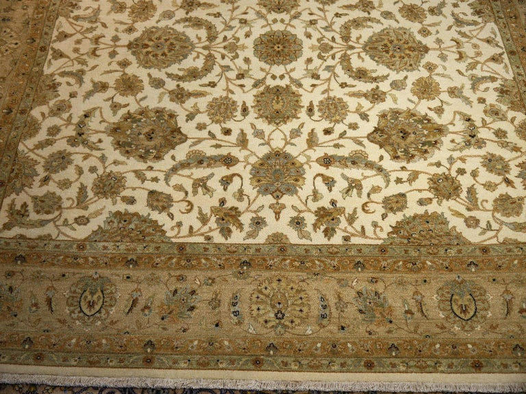 A beautiful square contemporary design carpet, hand knotted using finest wool. On a light crème field, the design of Lotus blossoms standing next to each other executed in green tones.  Design Influences are from Persian Tabriz and antique Ziegler