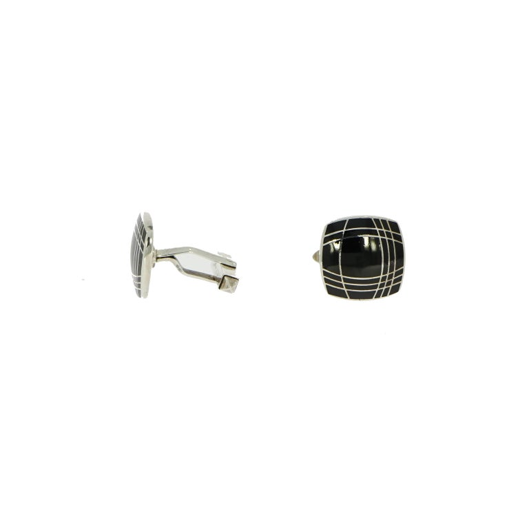 Cufflinks can be worn anytime by anyone and will transmit your style and define your look.  This stylish and modern black enamel cushion shaped (squared with rounded corners) cufflinks is handcrafted in sterling silver and highlighted with geometric