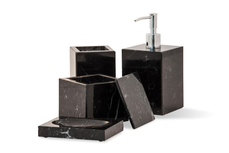 Squared soap dish in black Marquina marble with little holes for water.  Each piece is in a way unique (since each marble block is different in veins and shades) and handcrafted in Italy. Slight variations in shape, color and size are to be