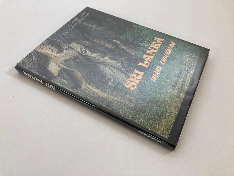 Sri Lanka : Island Civilisation. Zuber, Christian, Nadine Zuber and Senake Bandaranayake: Published by Boulogne : Delroisse, (1979) This is a beautiful rare coffee table book on Sri Lanka photography.