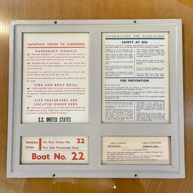 Hefty enameled solid aluminum framed passenger safety and information sign from Passenger Stateroom 139 on the Main deck of the SS United States.  Four glass paned windows. Lower right window is a pull-out sign plate identifying that assigned to
