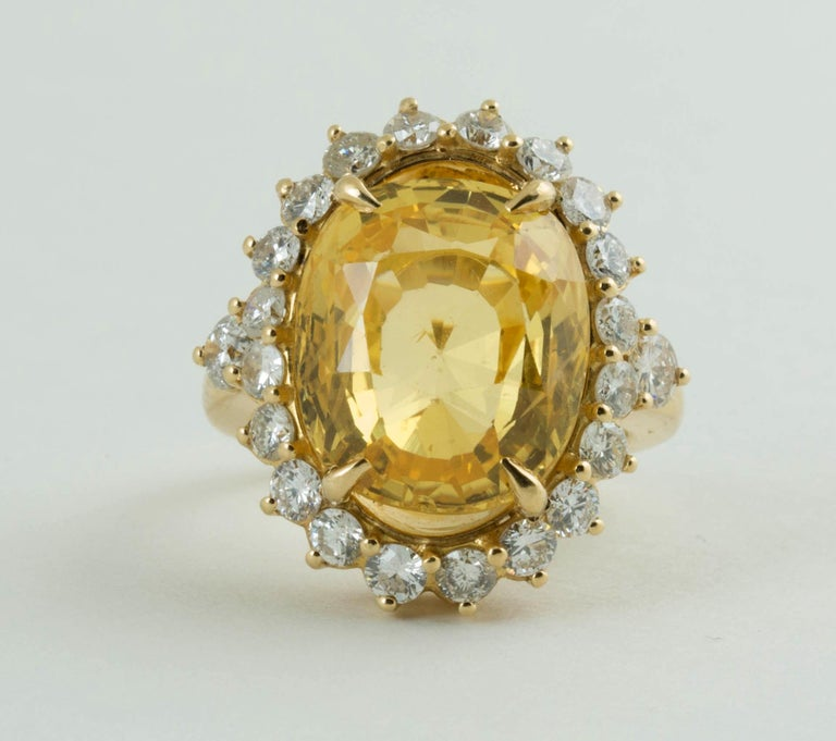 An antique 14 carat cushion mixed cut natural no heat yellow sapphire and diamond ring. Size of sapphire is 14.5mm x 12.35mm x 8.15mm. it is medium tone, strong saturation, yellow hue. come with Swiss Gemological Institute report #107813.  There are