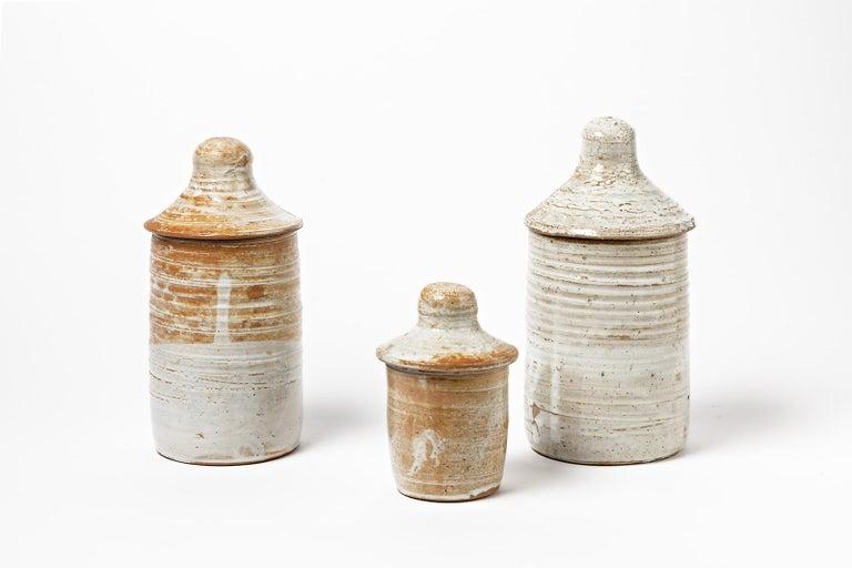 Eugene Lion,  circa 1940  Set of three decorative pots or boxes in stoneware ceramic.  Elegant white ceramic glaze color.  Original form of the 20th mid-century design.  n°1 height 15cm large 9cm N°2 height 24cm large 12cm N°3 height