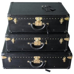 Stack of Black Louis Vuitton Alzer Suitcases, Louis Vuitton Trunks Louis Vuitton