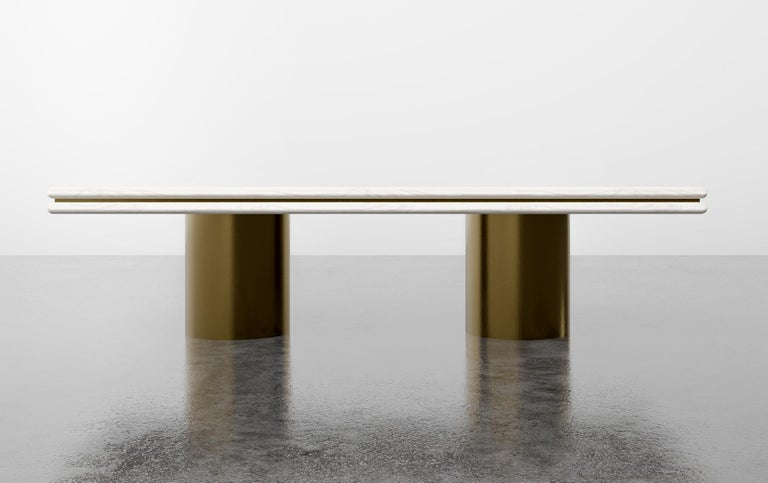 The stacked dining table is a modern dining table with a nod to the 1970s vernacular. As featured in bleached white oak with dark bronze metal inlay and metal bases $17,070.00 Starting at $14,490.00. Fully custom and made to order in California.