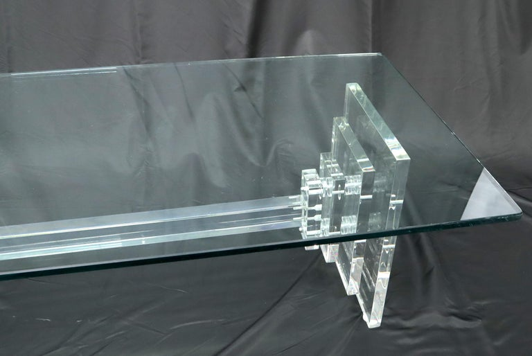 Mid-Century Modern heavy stacked Lucite base glass top coffee table.