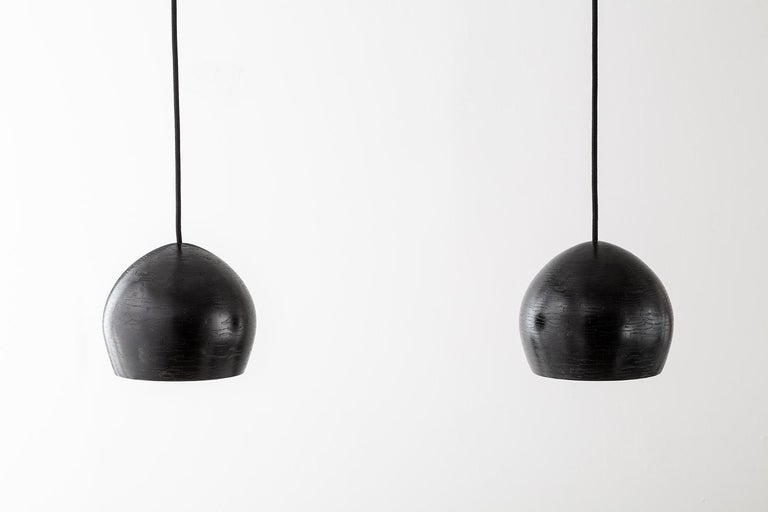 Shown in ebonized reclaimed ash; customizable.