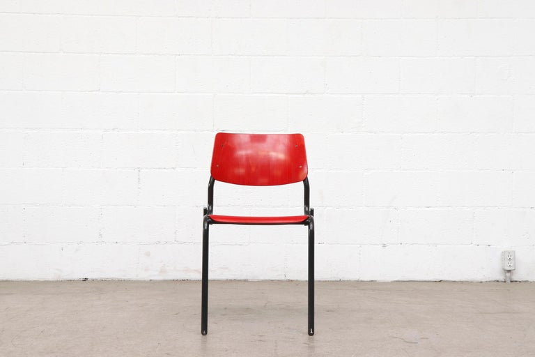 Beautiful Multi-Colored Stacking School or Restaurant Chairs with Black Enameled Metal Frames. In Good Overall Condition with Some Enamel Wear and Scratching Consistent with Age and Use. Listed Individually. Frame width is 18.875