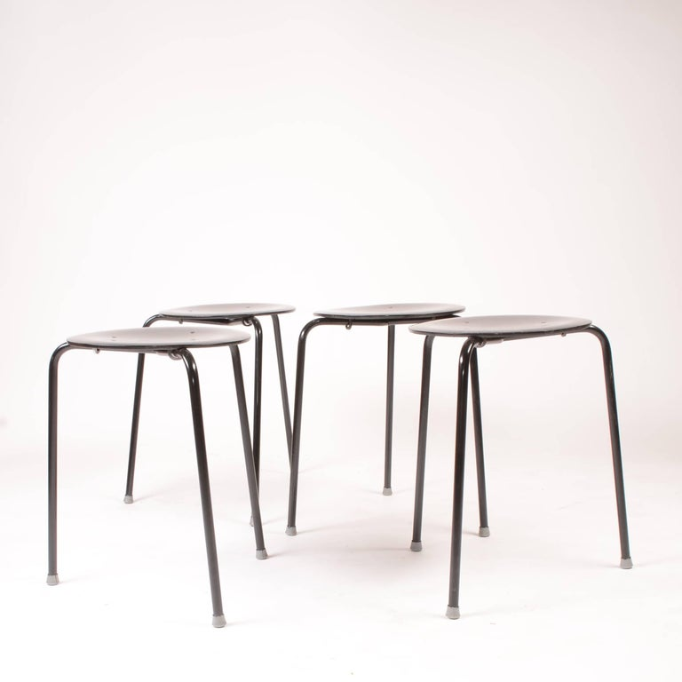 These are great stacking stools by Arne Jacobson. These stools have been professionally painted black. We have 8 in stock. Price is per stool.