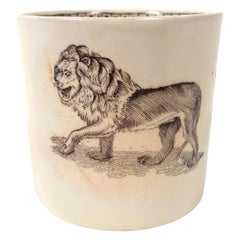 Staffordshire Child's Mug Decorated with a Striding Lion