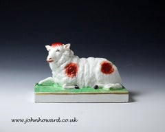 Staffordshire figure of a ewe on oblong base, English early 19th century period
