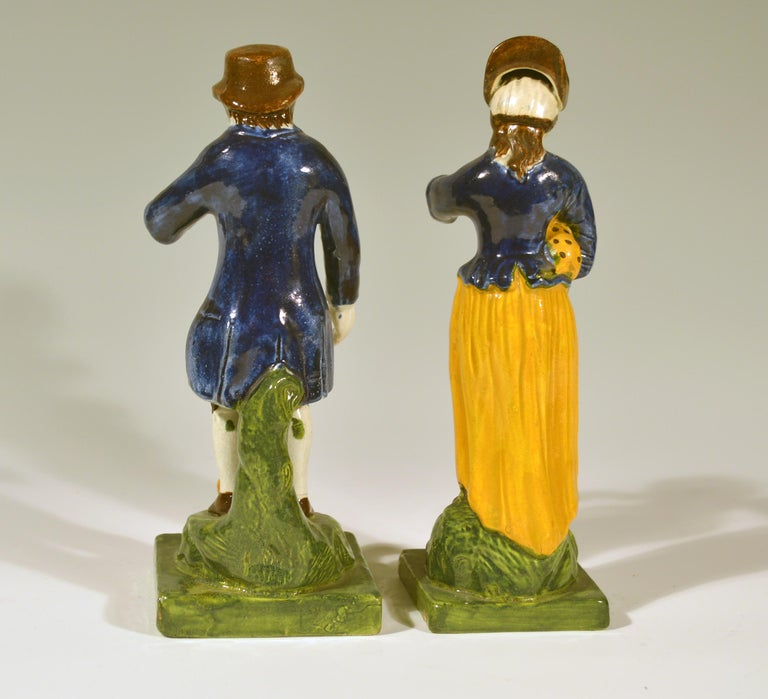 Georgian Staffordshire Pearlware Figures of Man & Woman with a Pet Dog & Cat, circa 1810 For Sale