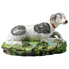Staffordshire Pearlware Pottery Setter Dog on Green Rocky Base, circa 1820